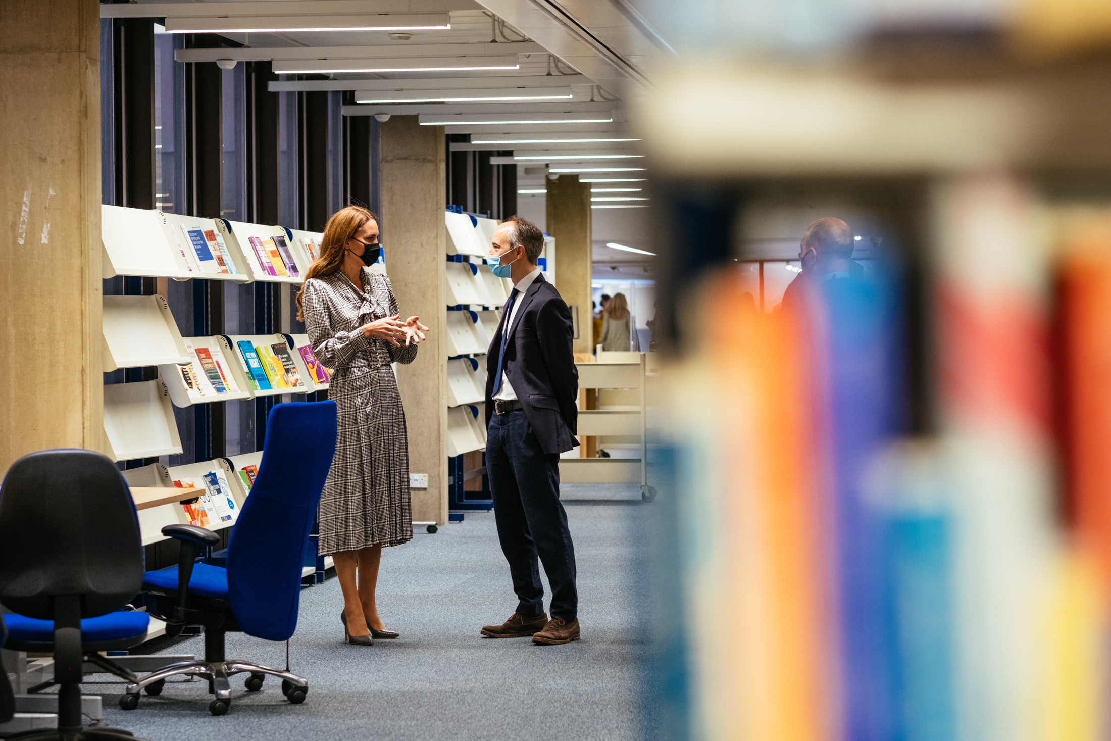 The Duchess of Cambridge and Pasco Fearon talking in the IOE Library